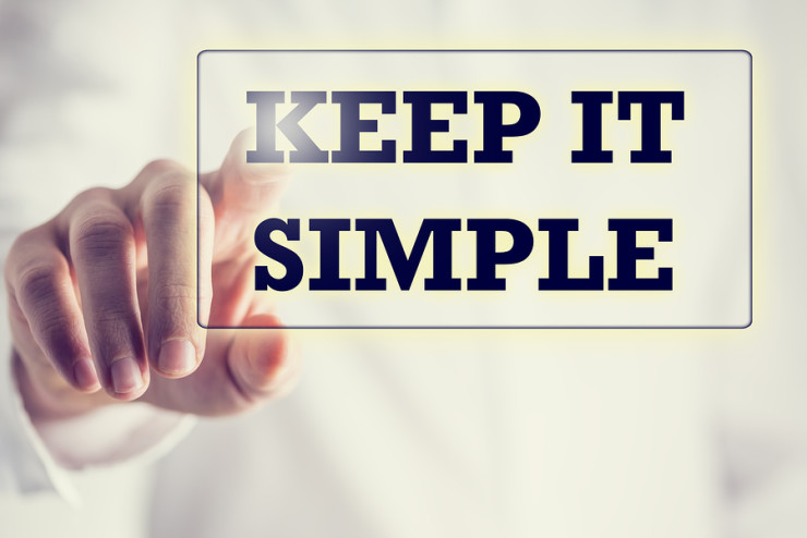 Keep It Simple in a navigation bar on a virtual screen with a businessman touching it to activate it from behind conceptual of simplicity clarity and easy understanding in business and in life.