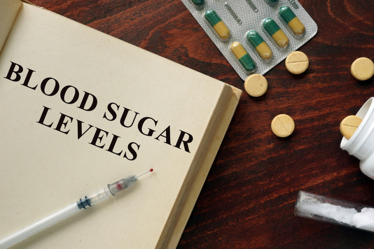 Blood sugar levels written on a book. Medical concept.