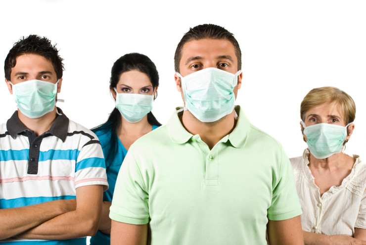Group of people with protective mask standing with hands crossed and looking at you isolated on white backgroundthis is a concept of protection from flu A-H1N1